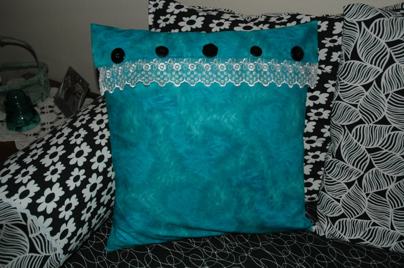 Aqua pillow with buttons